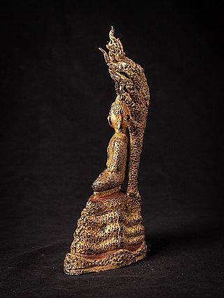 Antique Thai bronze Buddha on Naga snake