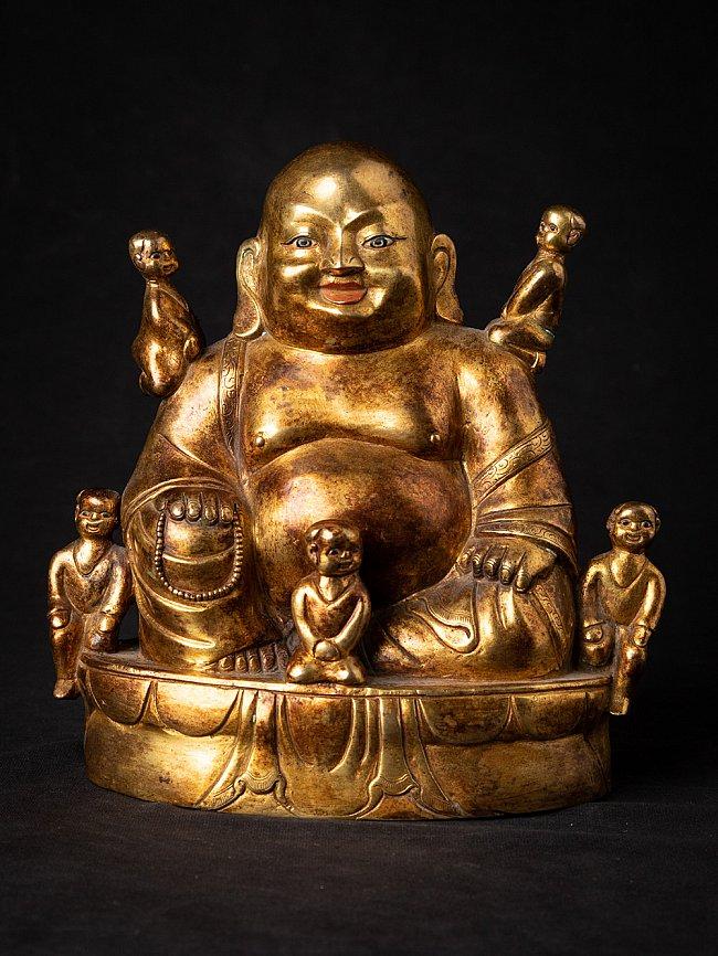 Old bronze Nepali Happy Buddha statue