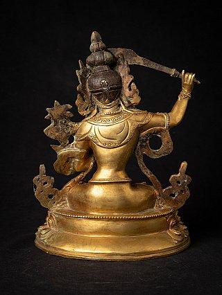 Old bronze Nepali Manjushri statue