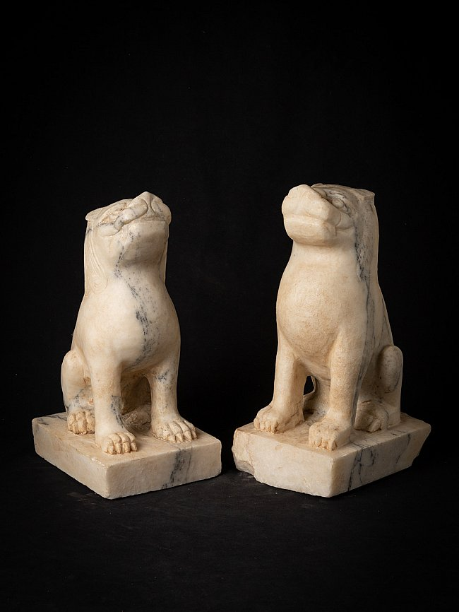 Pair of old marble lion statues