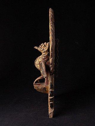 Antique wooden Peacock
