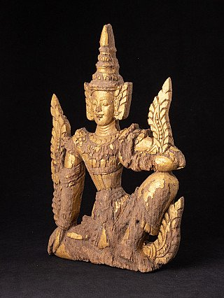 Antique wooden panel of Burmese Nat statue