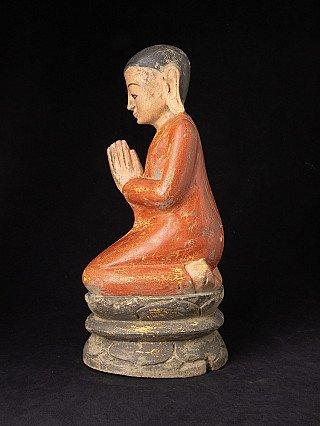 Old wooden Burmese monk statue