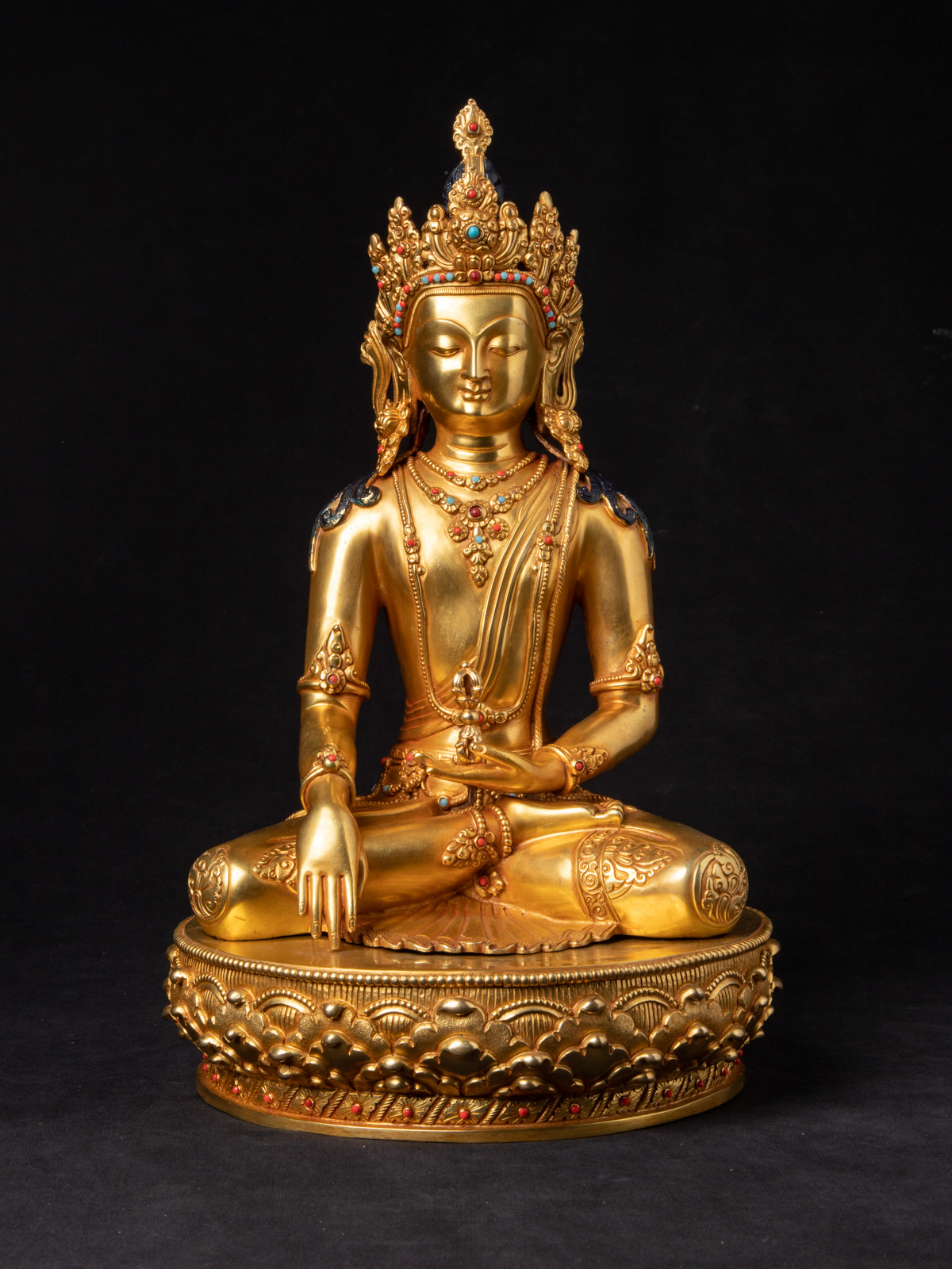 Large Nepali crowned Buddha statue from Nepal made from Bronze