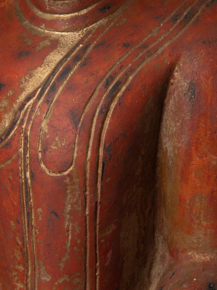 Antike holzerne Buddha Figur