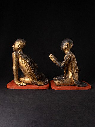 Antique pair of monk statues