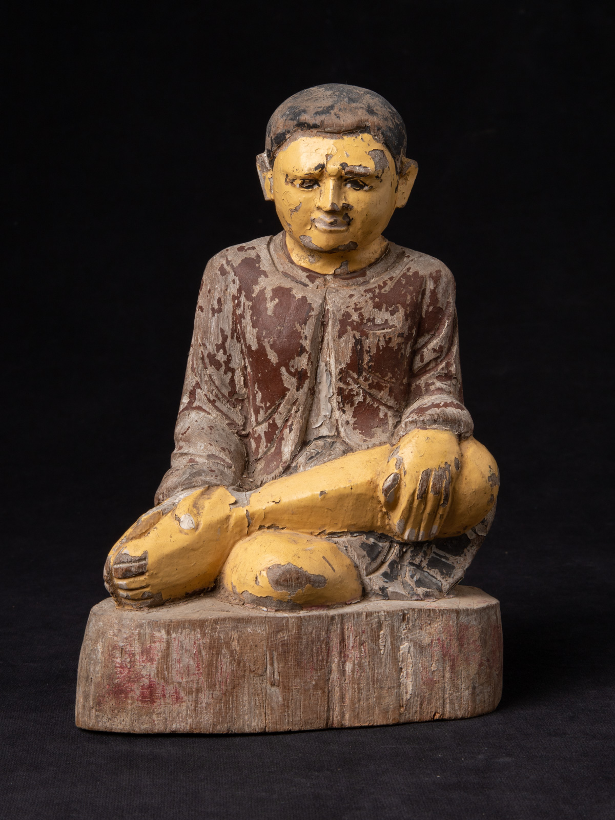 Old wooden Burmese monk statue from Burma