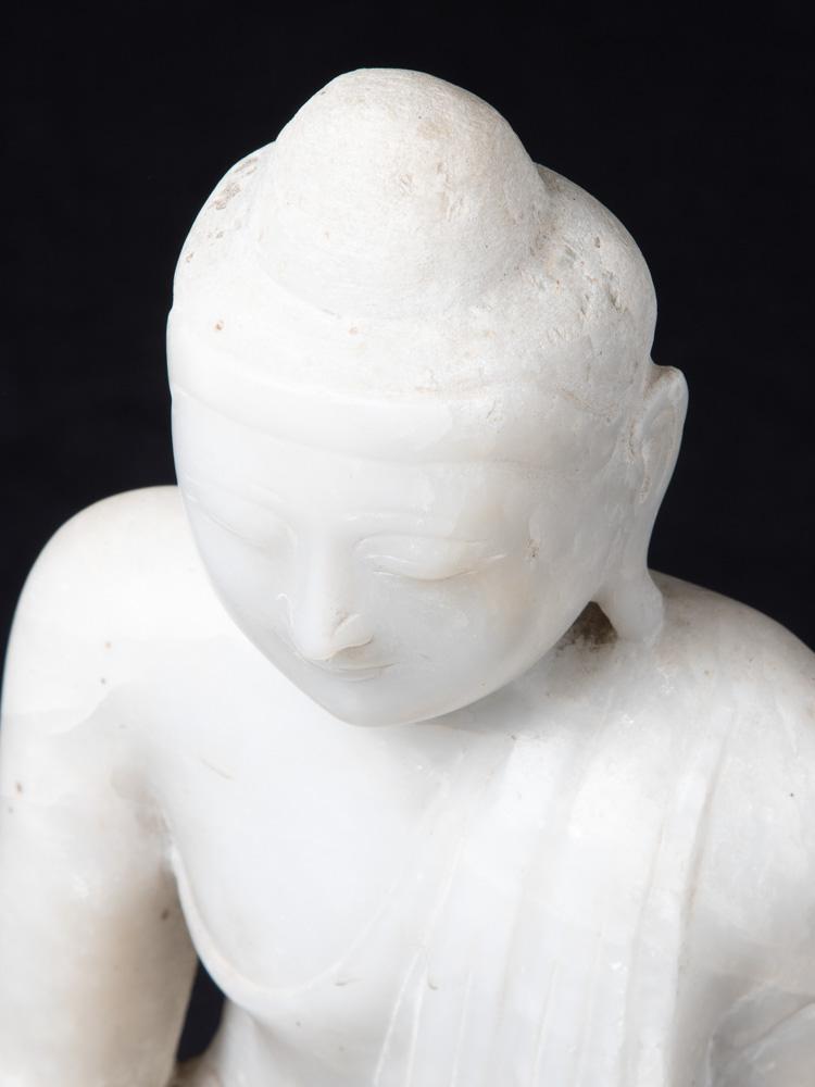 Old marble Mandalay Buddha statue