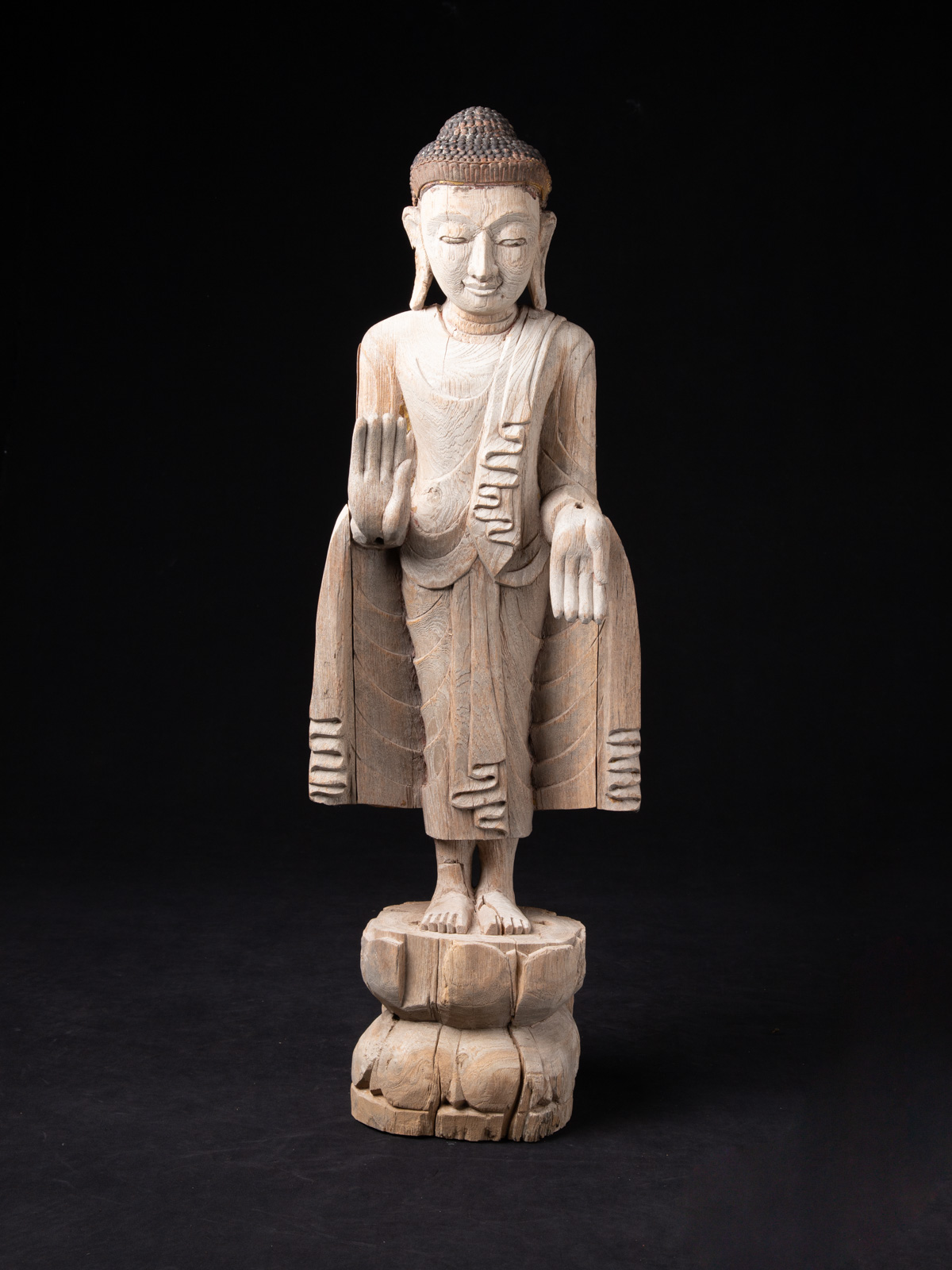 Old teakwooden Mandalay Buddha statue from Burma made from Wood