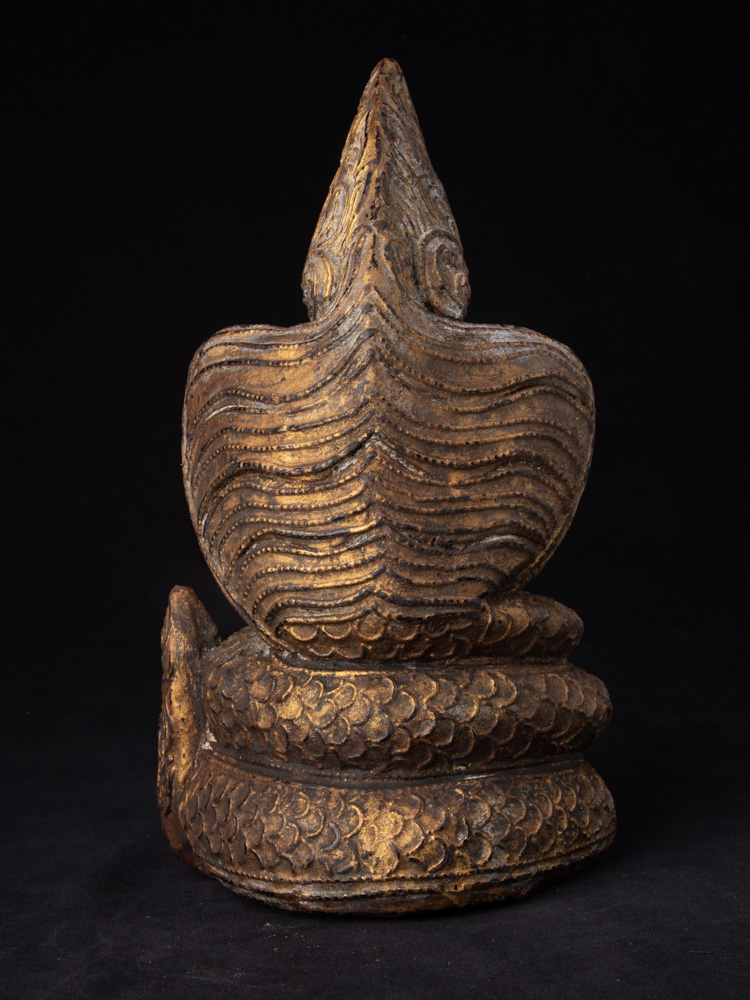 Old Buddha statue on Naga snake