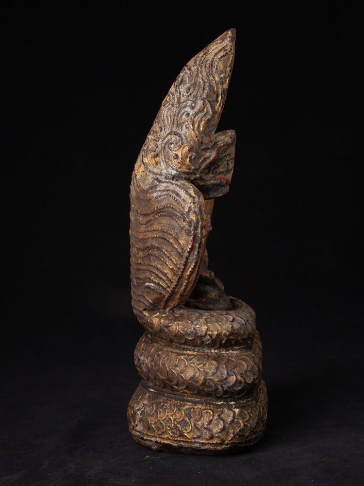 Old Buddha statue on Naga snake from Burma made from Wood