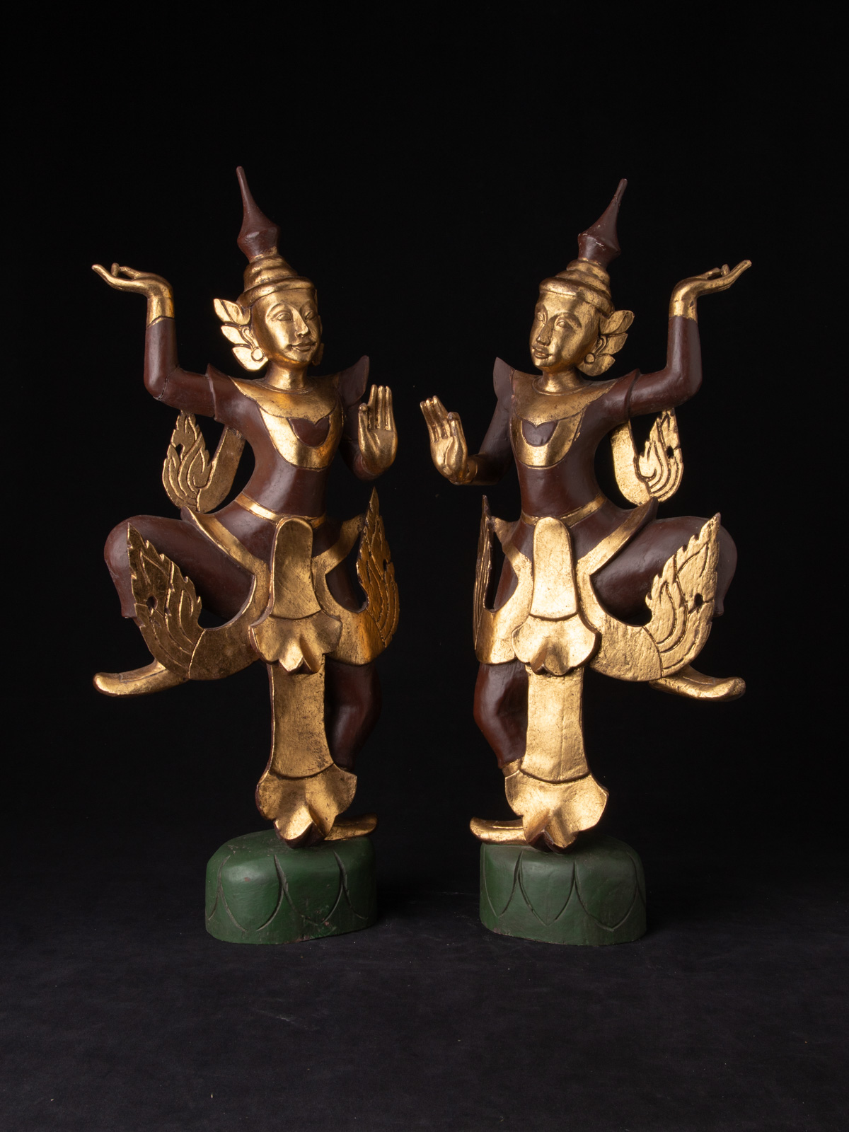 Pair of Burmese dancing figures from Burma made from Wood