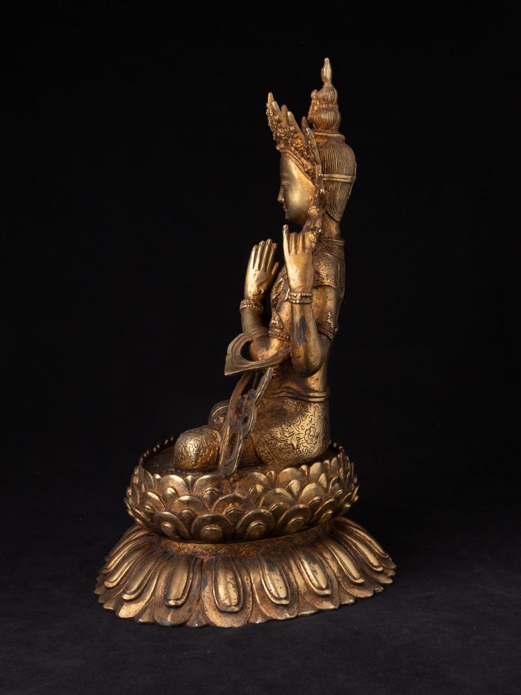Old bronze Chenrezig statue