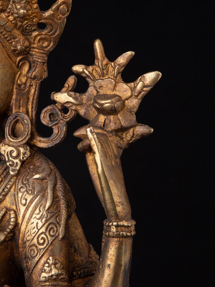 Oud bronzen Chenrezig beeld