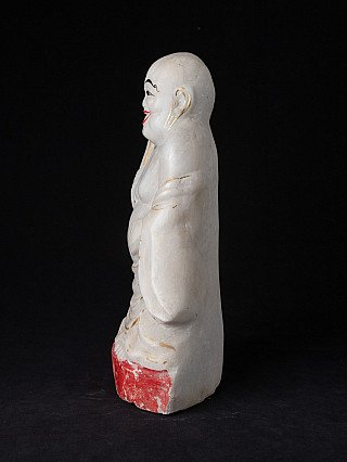 Old marble Happy Buddha statue