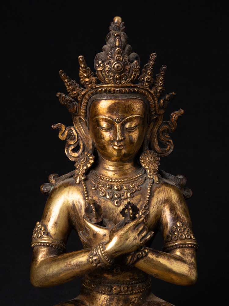 Old Nepali crowned Buddha statue from Nepal made from Bronze