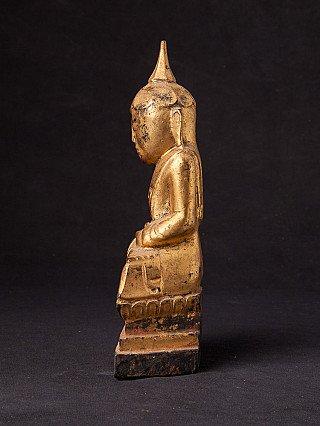 Antique wooden Buddha statue
