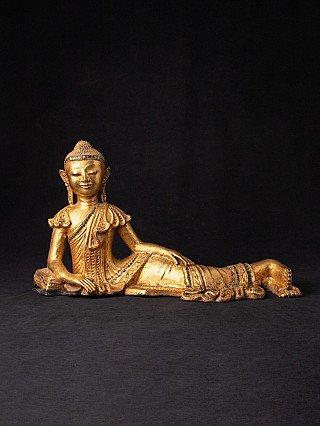 Old Burmese reclining Buddha statue
