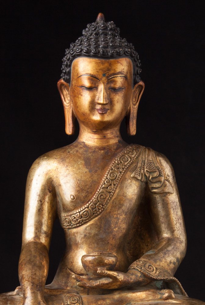 Old bronze Nepali Buddha statue from Nepal made from Bronze