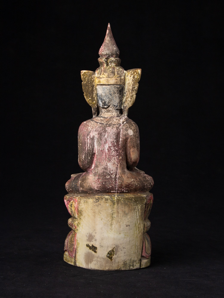 Old wooden crowned Buddha statue