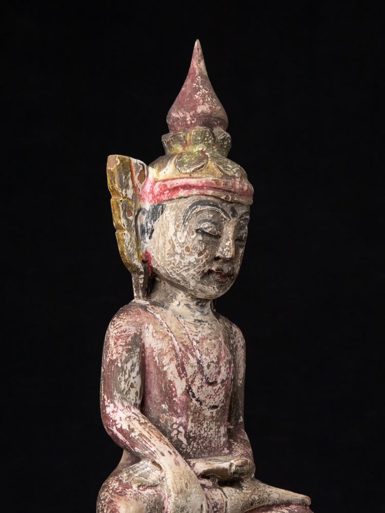 Old wooden crowned Buddha statue from Burma made from Wood