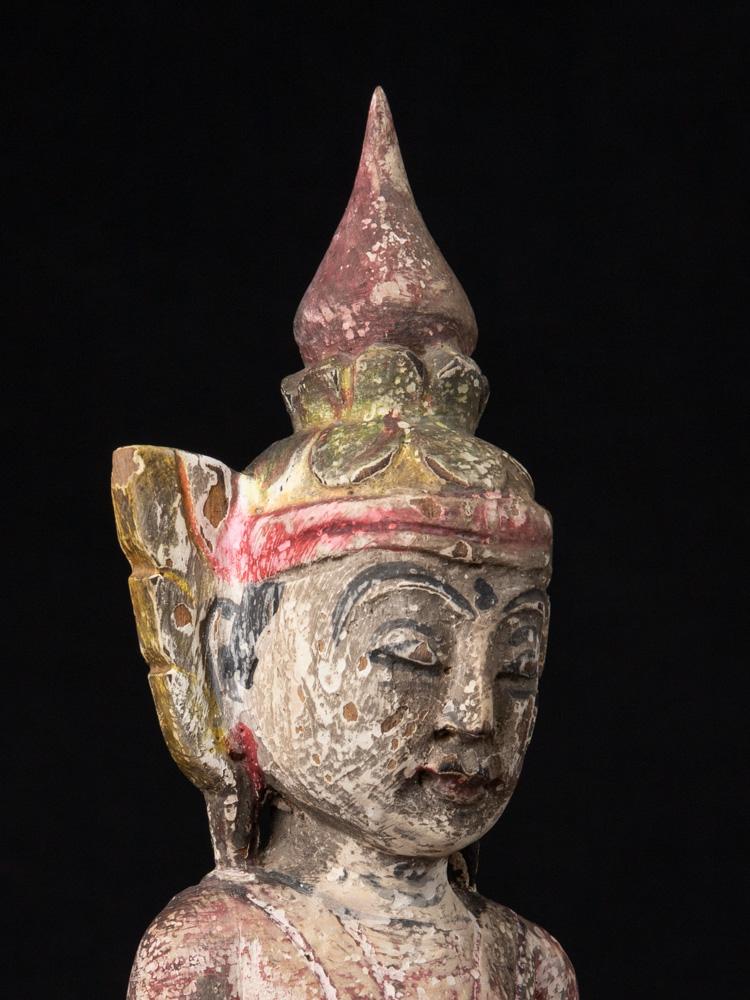 Oude houten gekroonde Boeddha