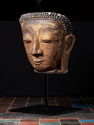 Antique stucco Buddha head