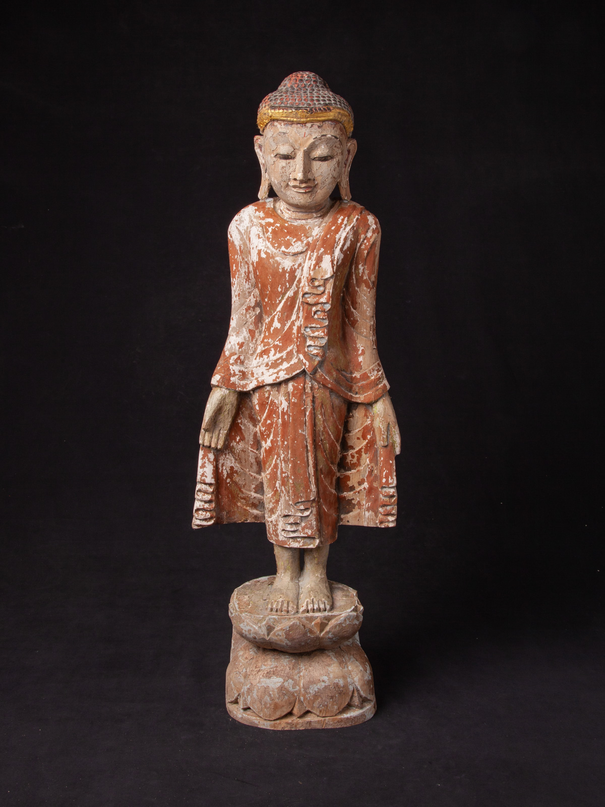 Old wooden Mandalay Buddha statue from Burma