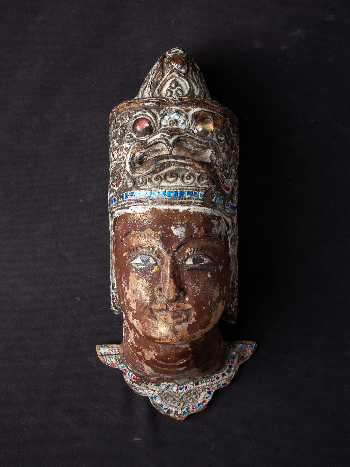 Old wooden head from Burmese spirit from Burma made from Wood