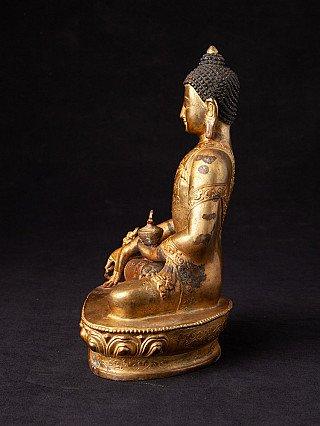 Old bronze Medicine Buddha statue
