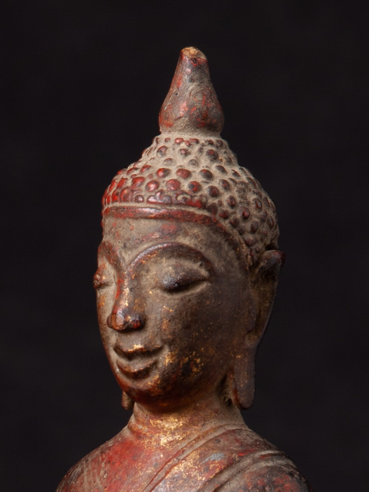 Antique wooden Laos Buddha statue from Laos made from Wood
