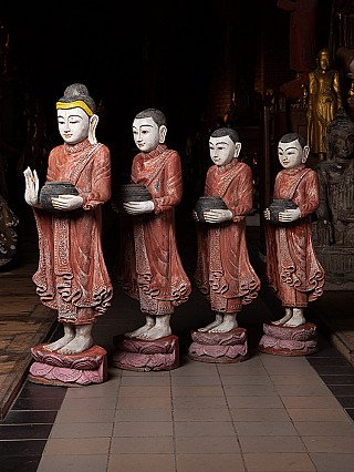 Old pair wooden Buddha and monk statues