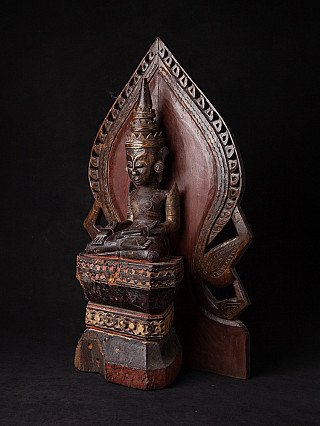 Antique wooden Mon Buddha statue