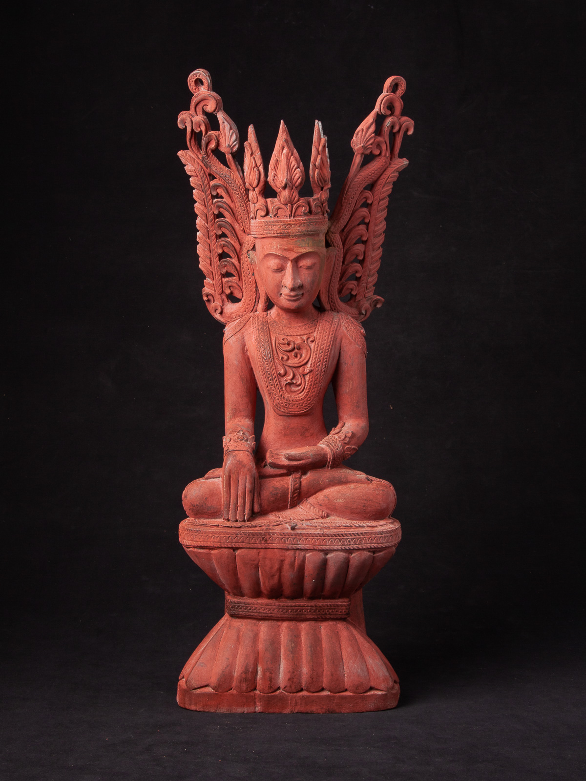 Old wooden crowned Buddha statue from Burma
