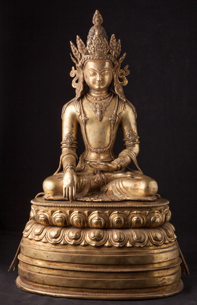 Old bronze crowned Buddha statue from Nepal made from Bronze