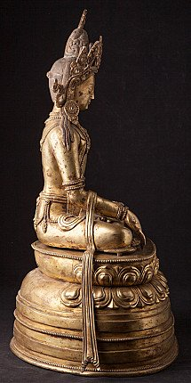 Old bronze crowned Buddha statue