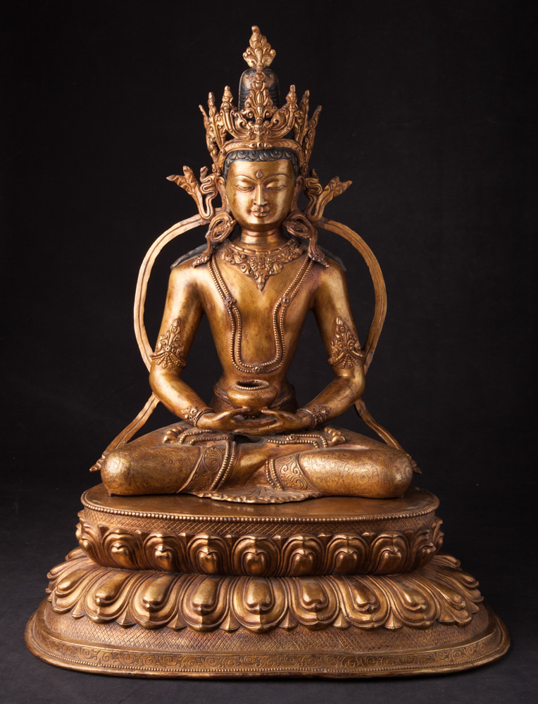Antique Nepali crowned Buddha statue from Nepal