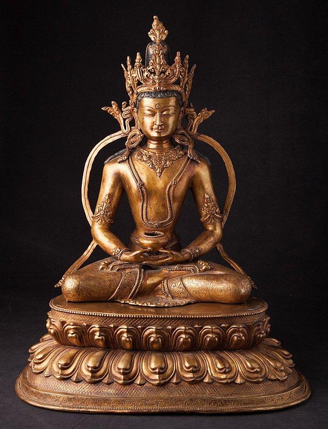 Antique Nepali crowned Buddha statue