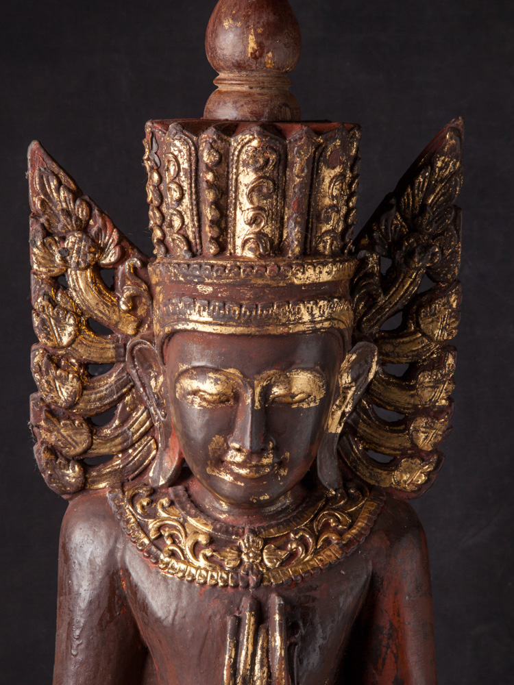 Old crowned Buddha statue from Burma made from Wood
