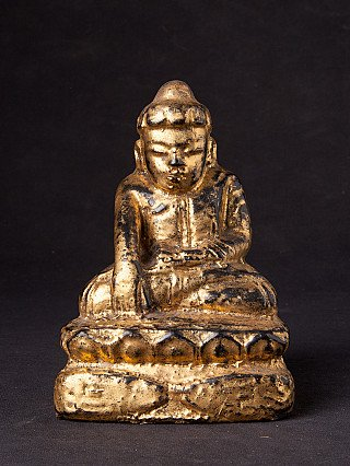 Antique wooden Lotus Buddha statue