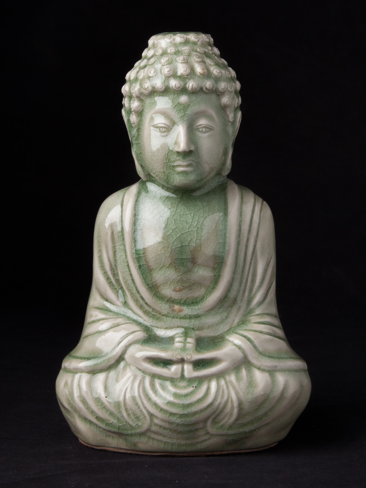 Old porcelain Buddha statue from China