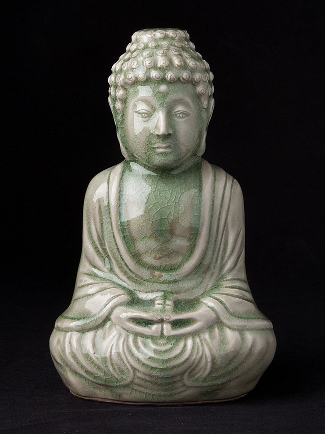 Old porcelain Buddha statue