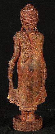 Wooden standing Buddha statue