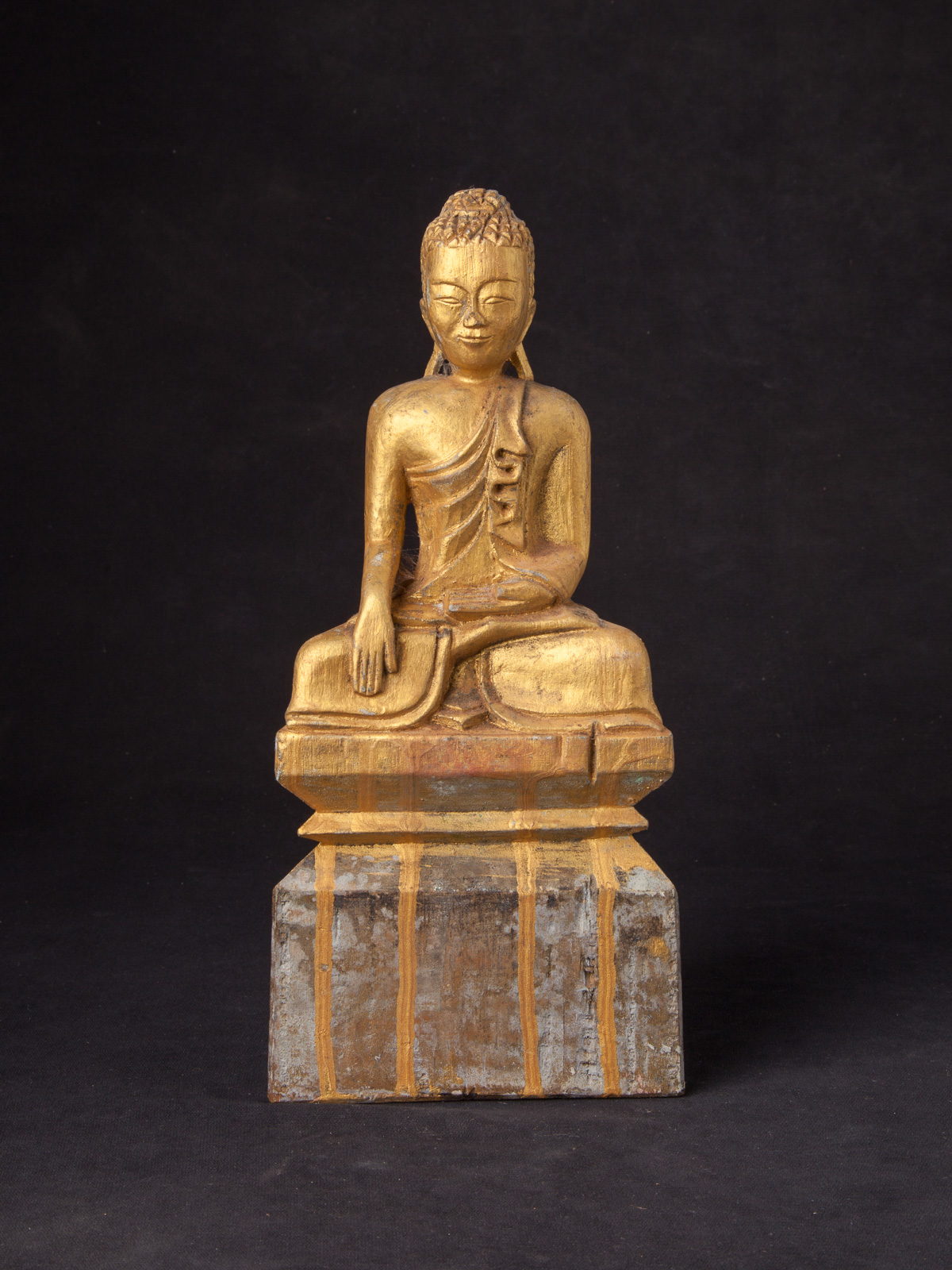 Old Burmese wooden Buddha statue from Burma