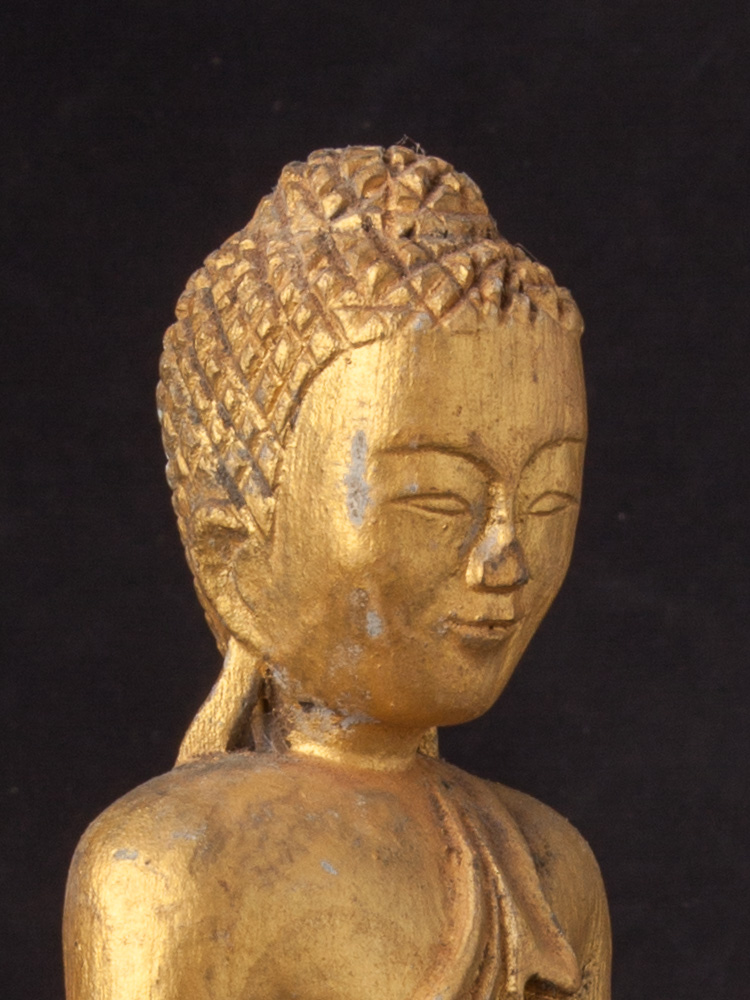 Old Burmese wooden Buddha statue from Burma made from Wood
