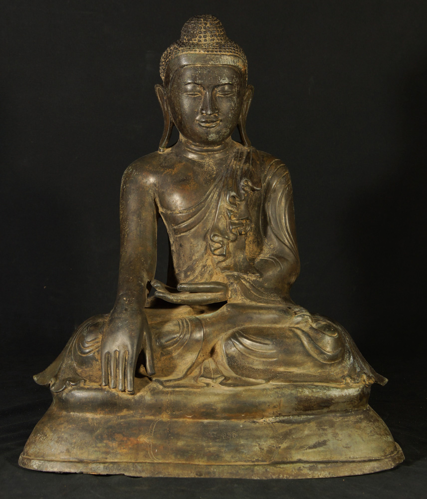 Old bronze Mandalay Buddha statue from Burma