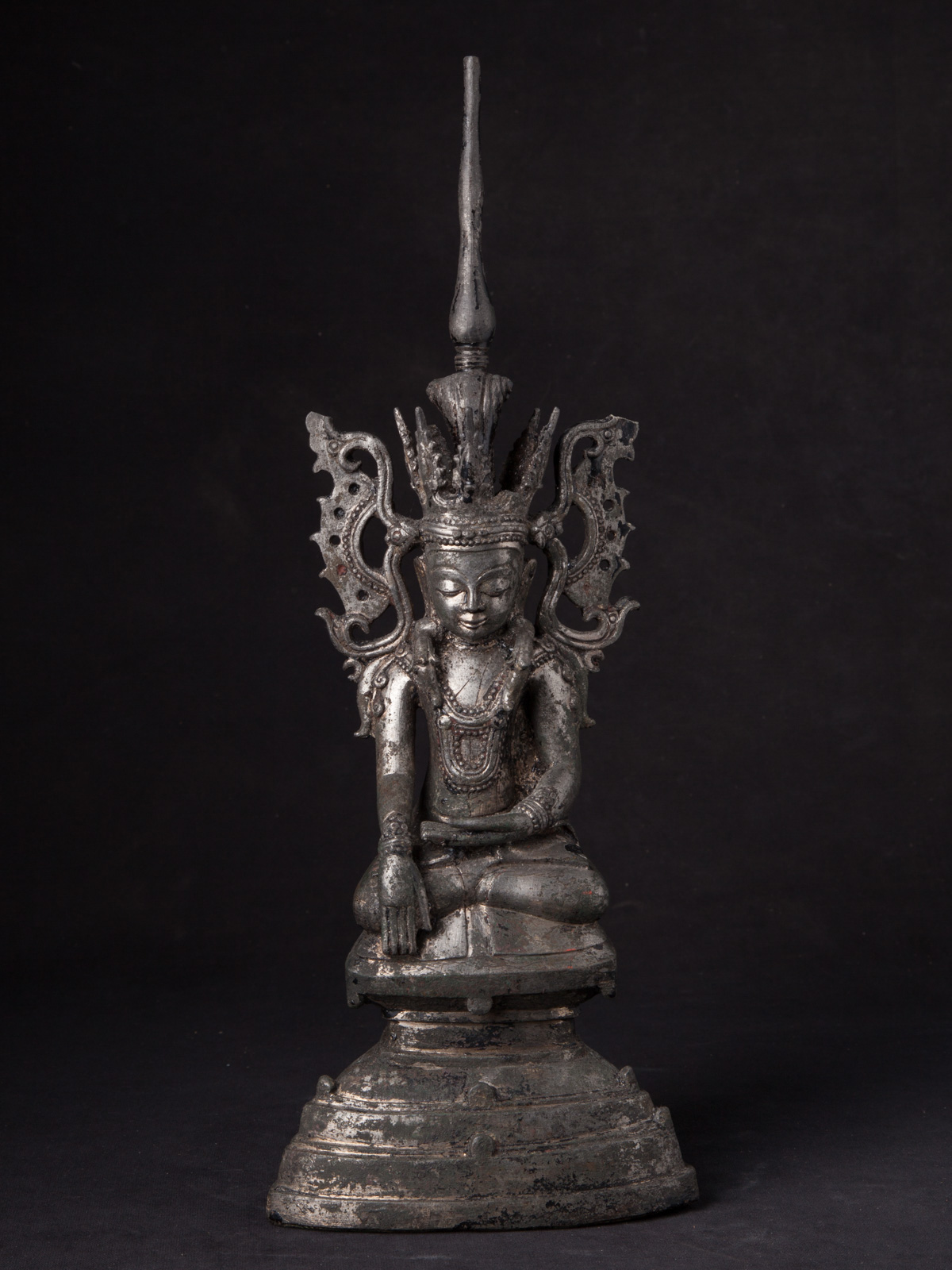 Antique bronze crowned Buddha statue from Burma