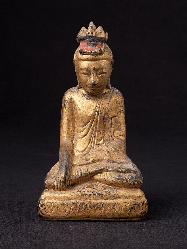 Antique Naga Buddha statue