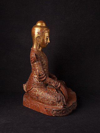 Antique wooden Buddha statue