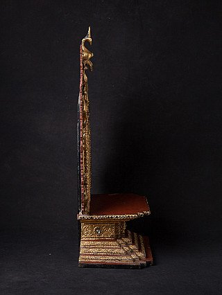 Antique wooden Buddha throne